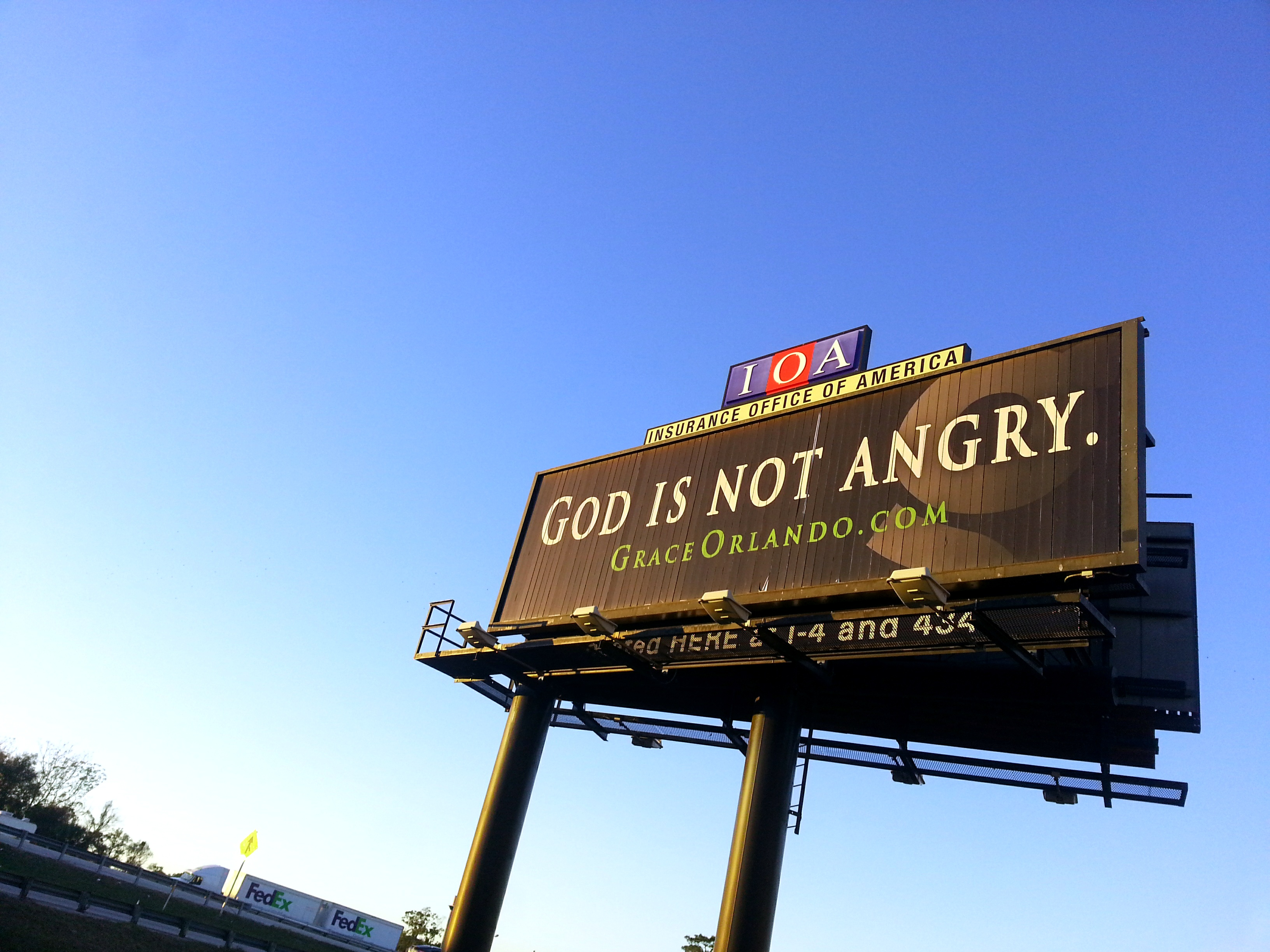 If 'GOD IS NOT ANGRY,' why is the billboard in all caps?