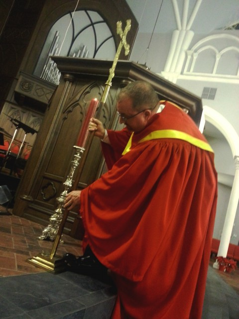 David Bray mounts the cross during the evening service at St. Andrew's Chapel in Sanford, Florida, on Dec. 28, 2014.