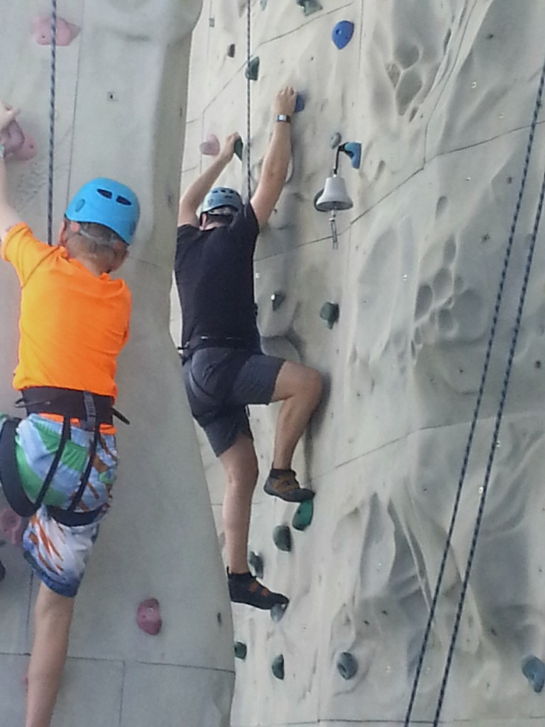 Getting beaten to the top of the rock wall by Ian Nichols, age 10.